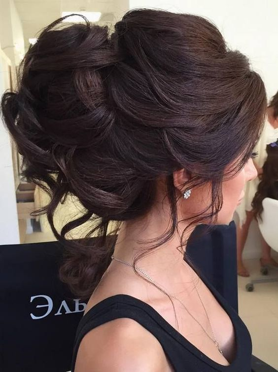 A beautiful bun with curls is the perfect look for women with long hair