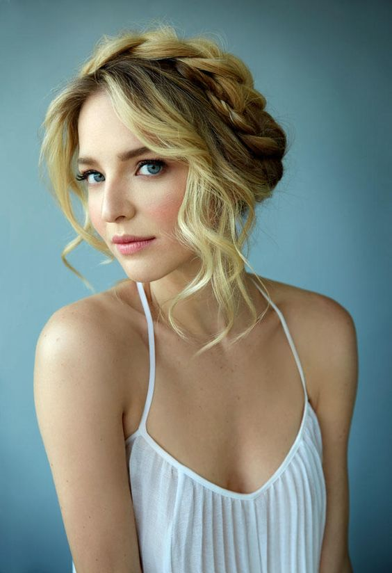 Romantic hairstyle with a braid around the head