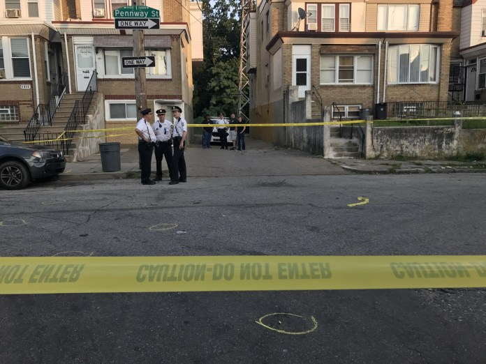 Police & crime scene investigators on the scene of an execution-style murder on the 5100 block of Pennway St. in Philadelphia Wednesday evening. (PHOTO: YC.NEWS/NIK HATZIEFSTATHIOU)