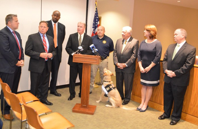 Pictured from left, Delaware County Councilmen Michael Culp, Dave White. Special Agent in Charge Marlon Miller of the U.S. Immigration and Customs Enforcement's (ICE) Homeland Security Investigations' (HSI), District Attorney Jack Whelan, Nat Evans, K9 handler and ICAC forensic analyst, Chairman Mario Civera, Jr., Vice Chair Colleen Morrone and Councilman John McBlain.