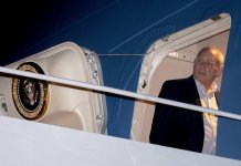 President Donald Trump's Chief of Staff John Kelly arrives at Andrews Air Force Base, Md., Monday, Feb. 19, 2018, after traveling with President Donald Trump from a holiday weekend at Mar-a-Lago in Palm Beach, Fla. (AP Photo/Andrew Harnik)