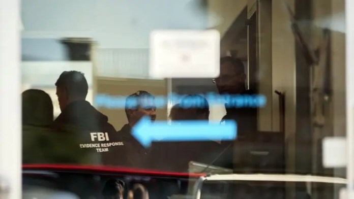 FBI officials work inside a FedEX Office store Tuesday, March 20, 2018, in the southwest Austin suburb of Sunset Valley, Texas, as authorities investigate a recent string of package bombs. (Reshma Kirpalani/Austin American-Statesman via AP)