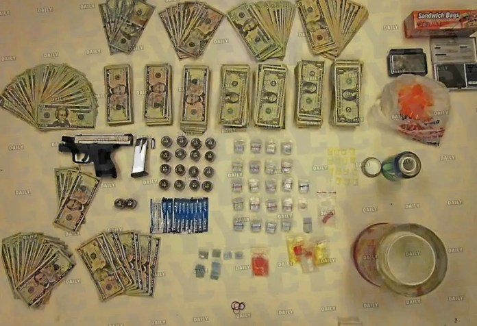 Evidence brave police officers gathered after executing a search warrant within the fortified walls of the Davidson 'drug warehouse' located in Upper Darby, Pennsylvania.