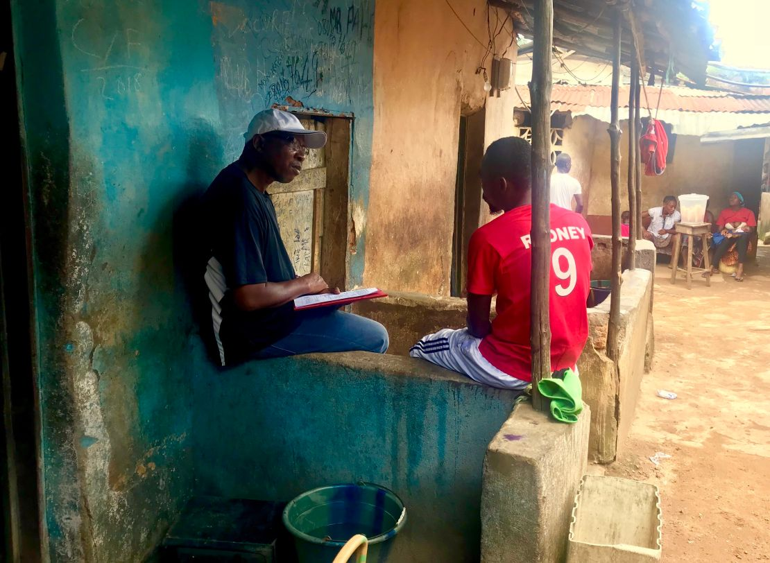 YMCA Sierra Leone - Trainer and Young person talking