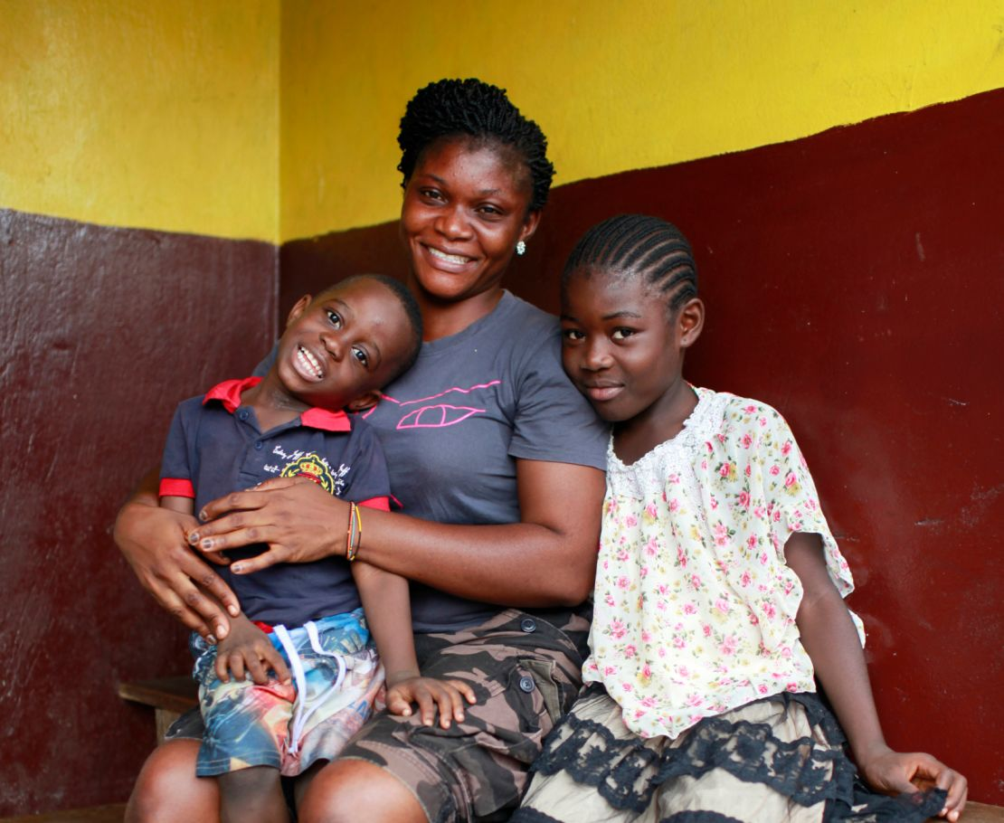Anita, DRR committee member for YMCA Liberia, with her children