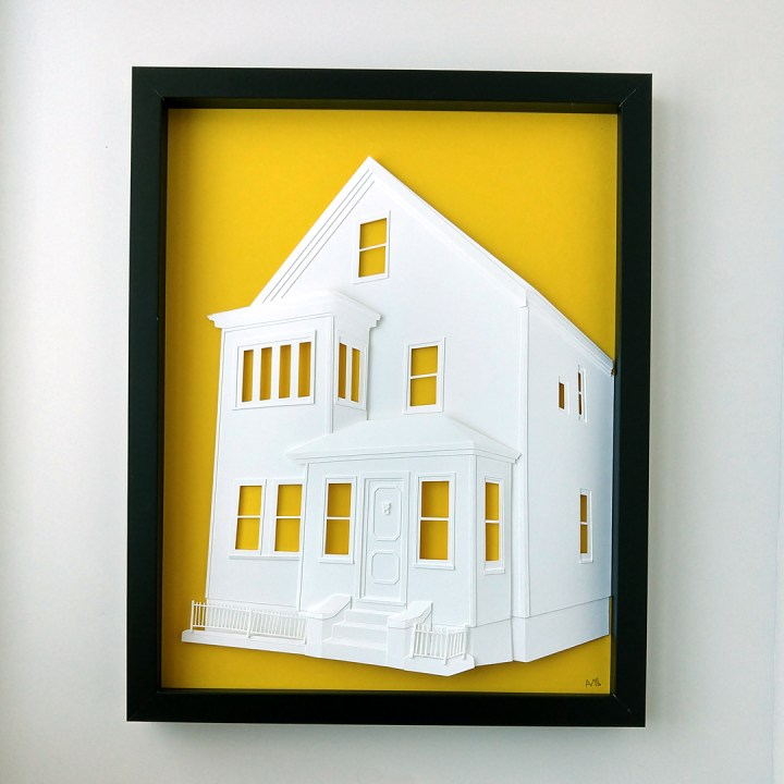 Finished paper house portrait on bright yellow background