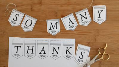 """Partially-assembled printed """"So Many Thanks"""" banner"""