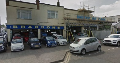 Plans to demolish used car dealership for flats thrown out by councillors