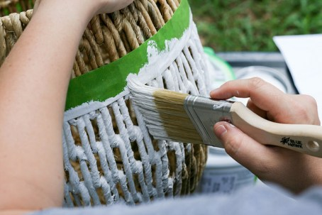 Paint away from the tape, not towards it. You don't want your paint dripping between the wicker.