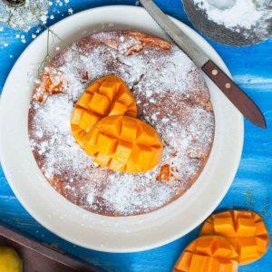 Summertime Eggless Fresh Mango Cake - Basic Eggless Vegetarian Sponge with chunks of Fresh alphonso Mango pieces in it.