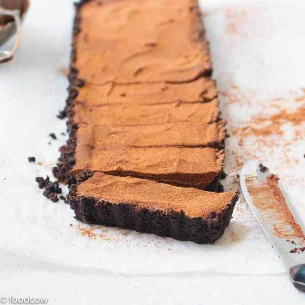 No Bake Oreo Chocolate Tart - Easy Eggless Chocolate Pie with Crushed chocolate biscuit tart shell and creamy dark chocolate ganache filling.