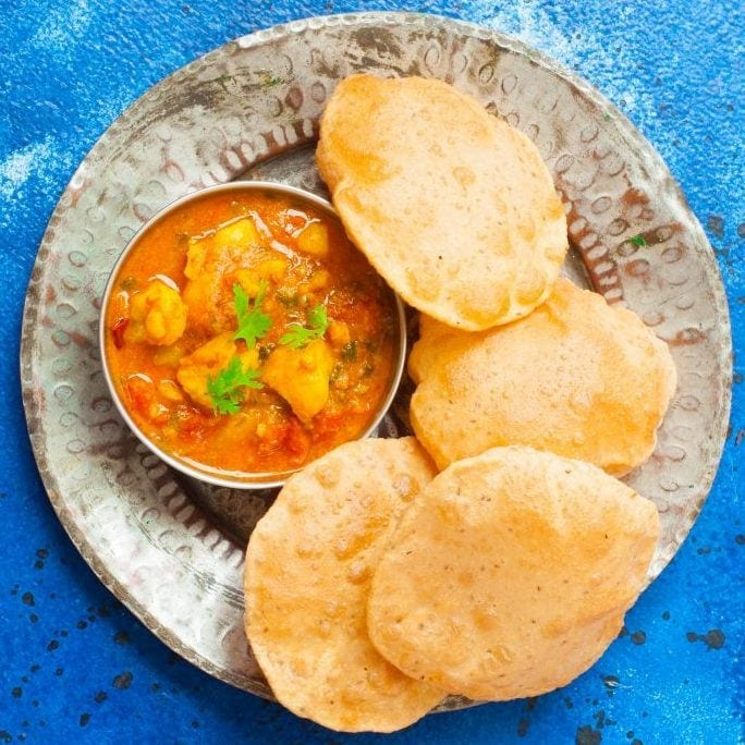 Aloo Tamatar Sabzi - North indian Potato curry made in the pressure cooker,served with Pooris and Kachories during festivals and fasts.