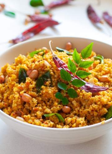 Tamarind Rice with Foxtail Millet - A delicious and easy to make ,healthier Puliyodhrai recipe using millets instead of rice. #millets #foxtailmillet #healthy #healthyeating #southindian #puliohare #tamarind #tamarindrice #milletrecipe #indianrecipe #milletrecipe