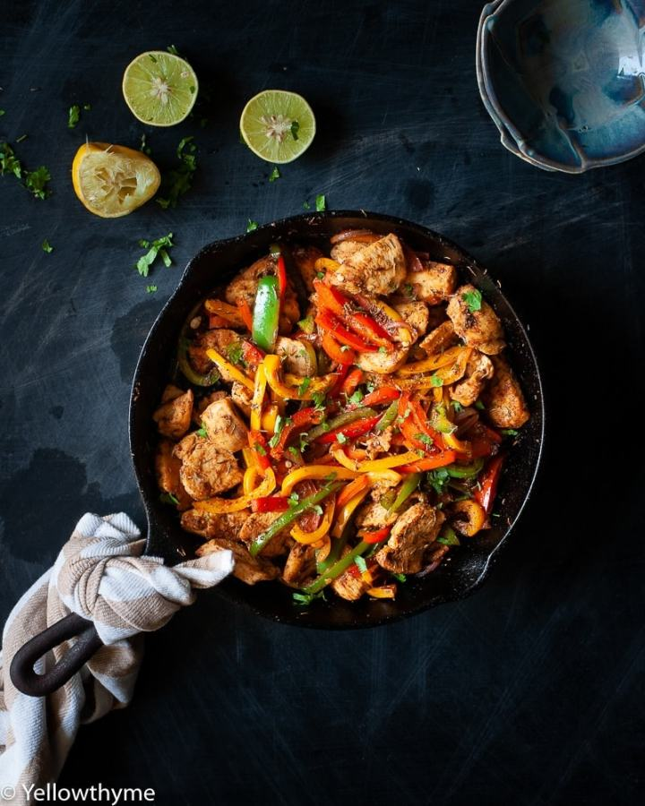 Healthy Fajita Chicken with Bell Peppers - Whole 30 and Paleo approved Chicken cooked in homemade Fajita Seasoning with red,yellow and Green Bell peppers.