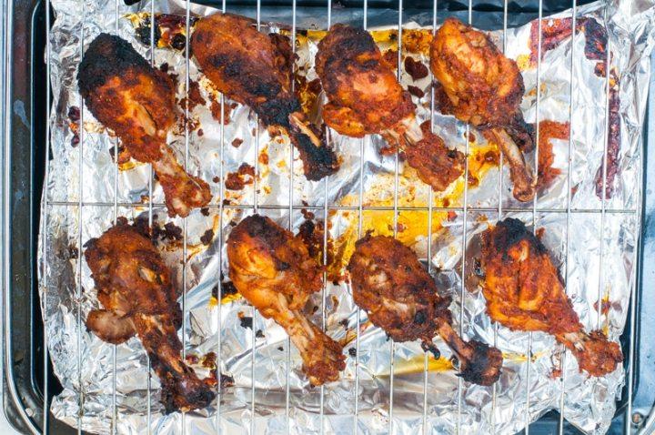 Tandoori Chicken drumsticks on a roating tray