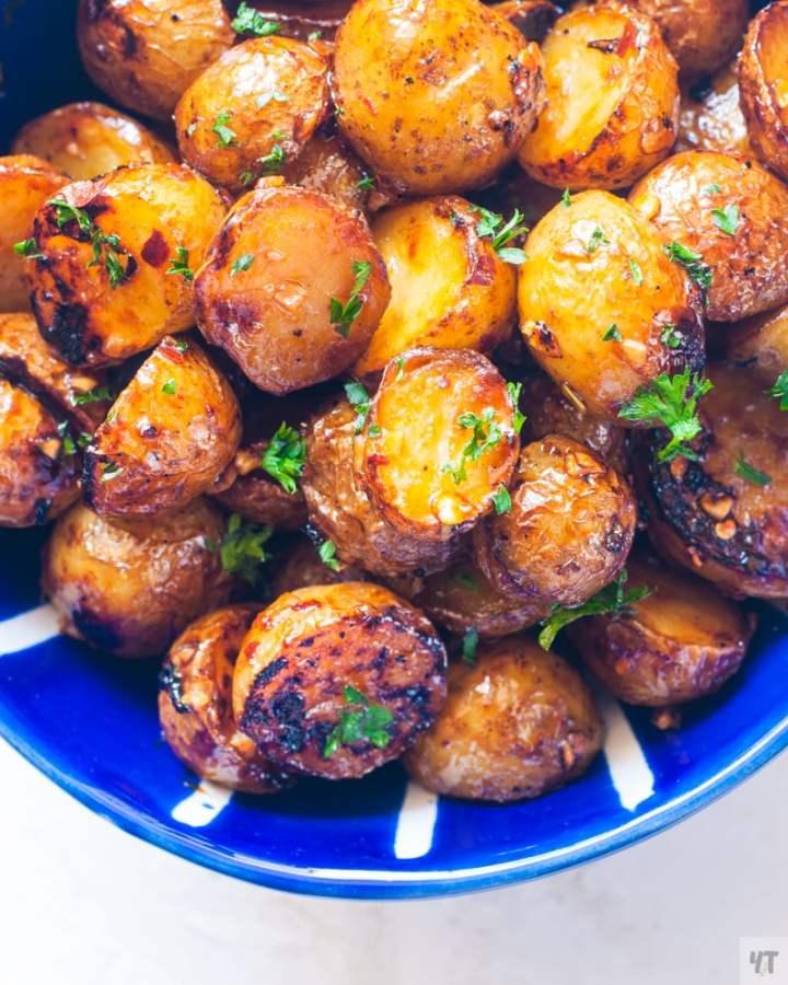 Crispy Honey Garlic Baby Potatoes in a blue bowl