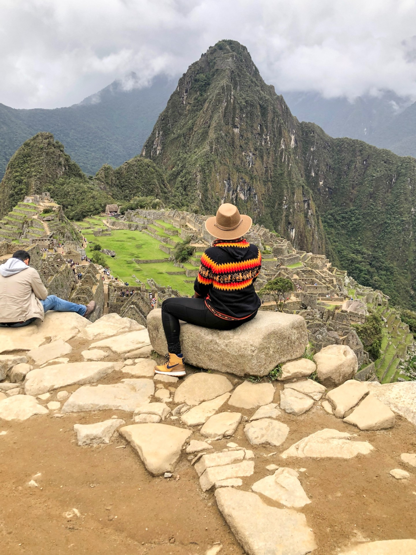 Black traveler in Machu Picchu wearing Nike hiking boots
