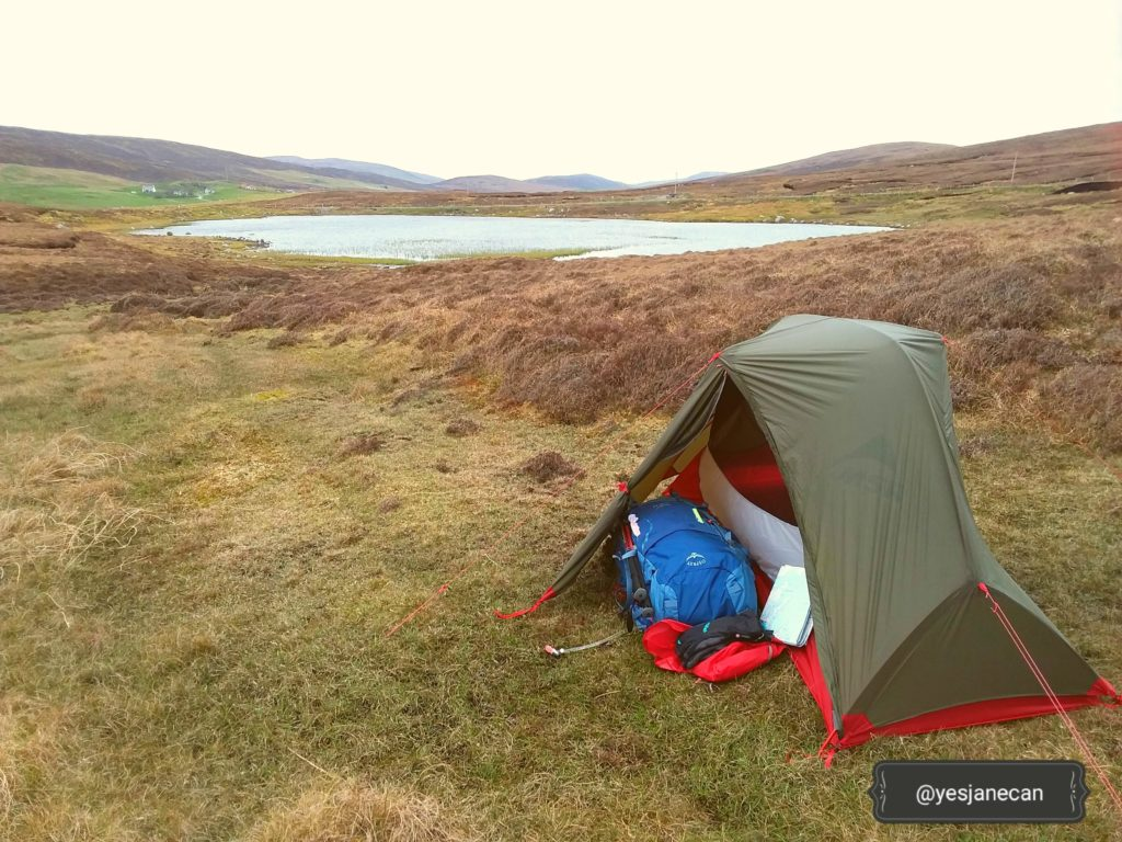 Camping near a loch in Shetland while wild camping in Scotland