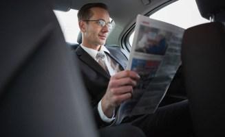 Businessman Reading Newspaper photo from Shutterstock