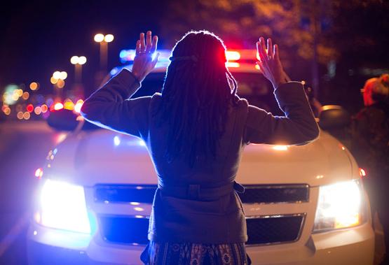 """Hands Up Don't Shoot"" with cop car by Joshua Sinn"