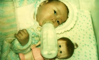 1.JS-LEE-infant-with-white-doll-.jpg