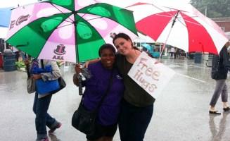 Volunteer giving a free hug at the Ferguson Farmers Market. Photo courtesy of Molly Rockamann.