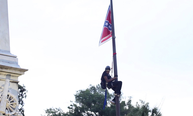 Bree Newsome climbs a flagpole in Columbia