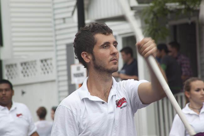 young man waving banner