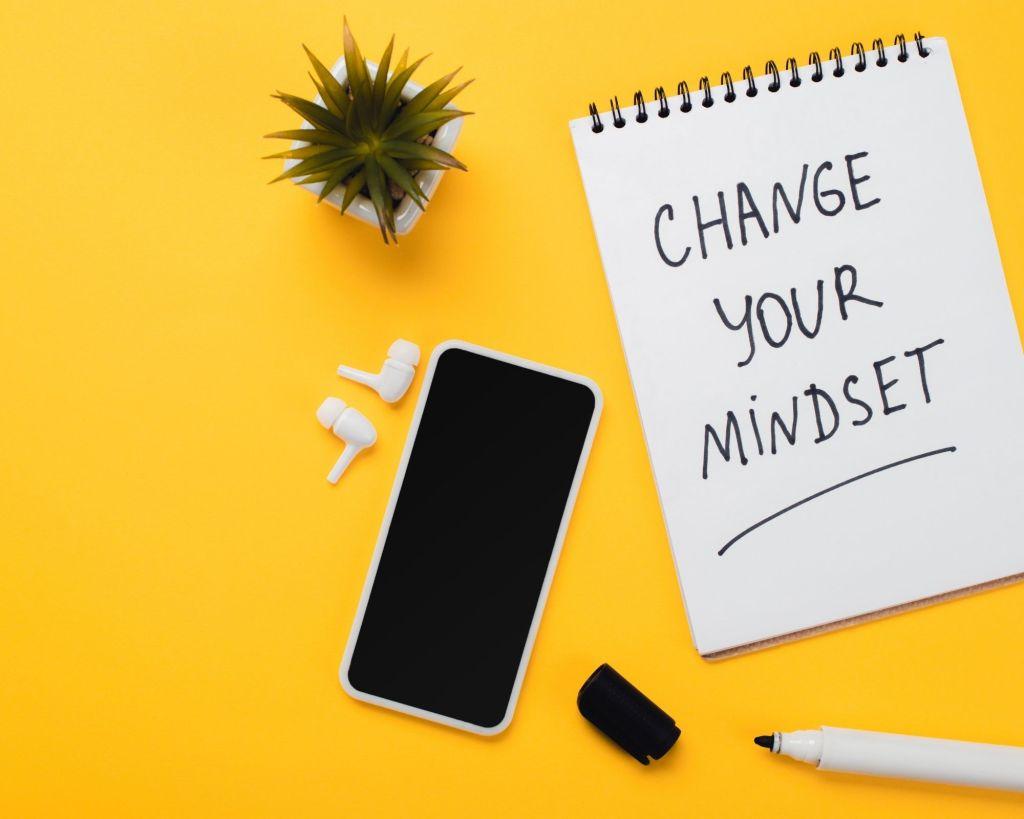 telephone stylo bloc note change your mindset