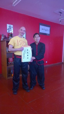 Sifu Hepple presented with a personalised attendance certificate for the junior seminar by Great Grandmaster Yee Chi Wai (june 2016)