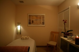 A soothing, warm, low-lit treatment room.