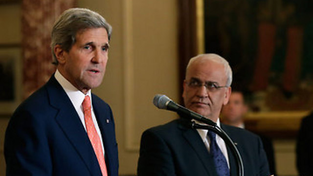 John Kerry and Saeb Erekat