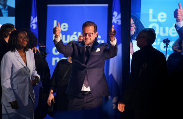 The photo depicts the Bloc Québécois leader, Yves-François Blanchet, smiling and showing thumbs up in reaction to a successful for his party Oct. 21, 2019 federal election.
