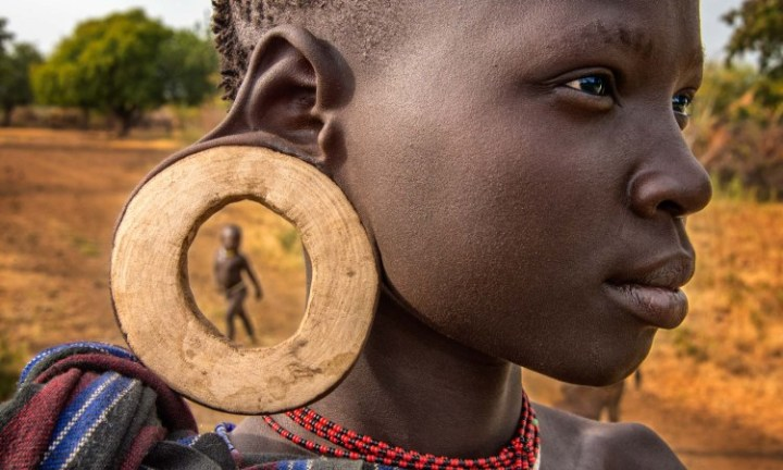 Mursi tribes woman with her ear plate