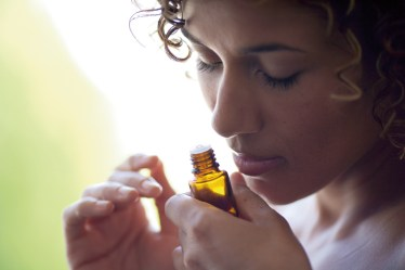woman smelling essential oils