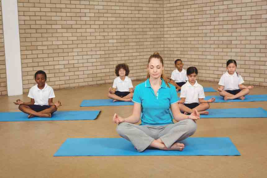 Students and teacher doing yoga pose