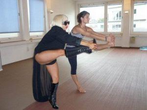 Lady Gaga doing yoga in thigh highs