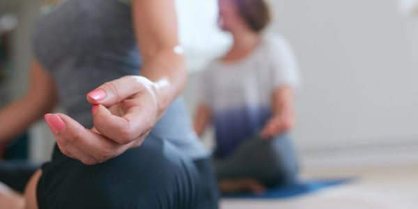Meditating Womans Hand During Yoga Class