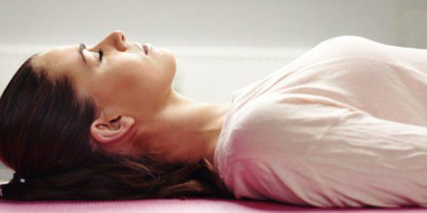 cropped-bigstock-Woman-Lying-On-Yoga-Mat-Relaxi-68262496.jpg