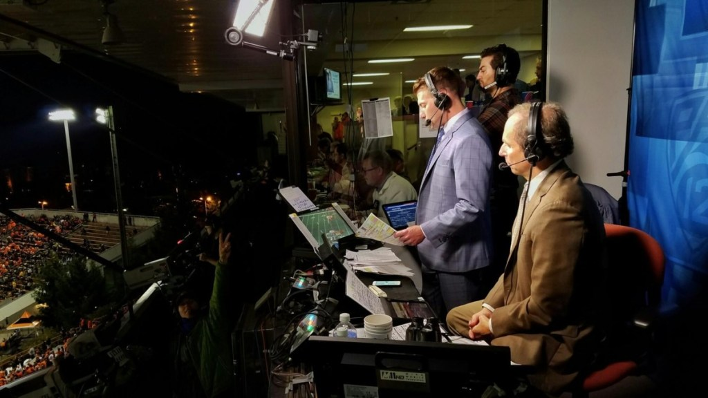 Roth and his partner, Ted Robinson, in the booth in 2016
