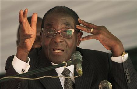 Zimbabwe President Robert Mugabe addresses a memorial service for retired general Solomon Mujuru at Ruzambo Farm in the Beatrice area, about 65 km (40 miles) south of the capital Harare, May 5, 2012. REUTERS/Philimon Bulawayo