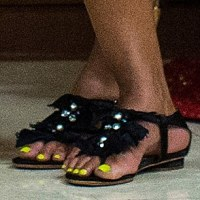 Michelle Obama has a very neon Christmas with highlighter yellow pedicure in Hawaii
