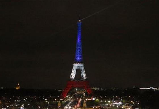 The Eiffel Tower is illuminated in the French national colors red, white and blue