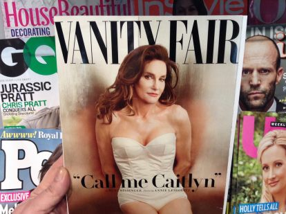 Caitlyn Jenner debuted her coming out process on the cover of Vanity Fair with flowing red hair, pale skin, dainty lips, and a tightly fitted white bodice.