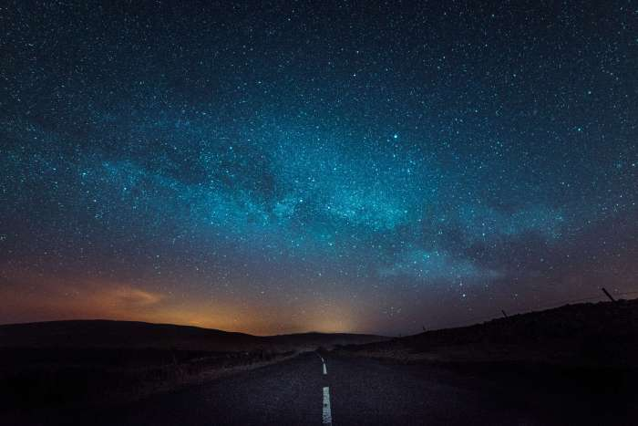 A starry night over a road leading to Ribblehead