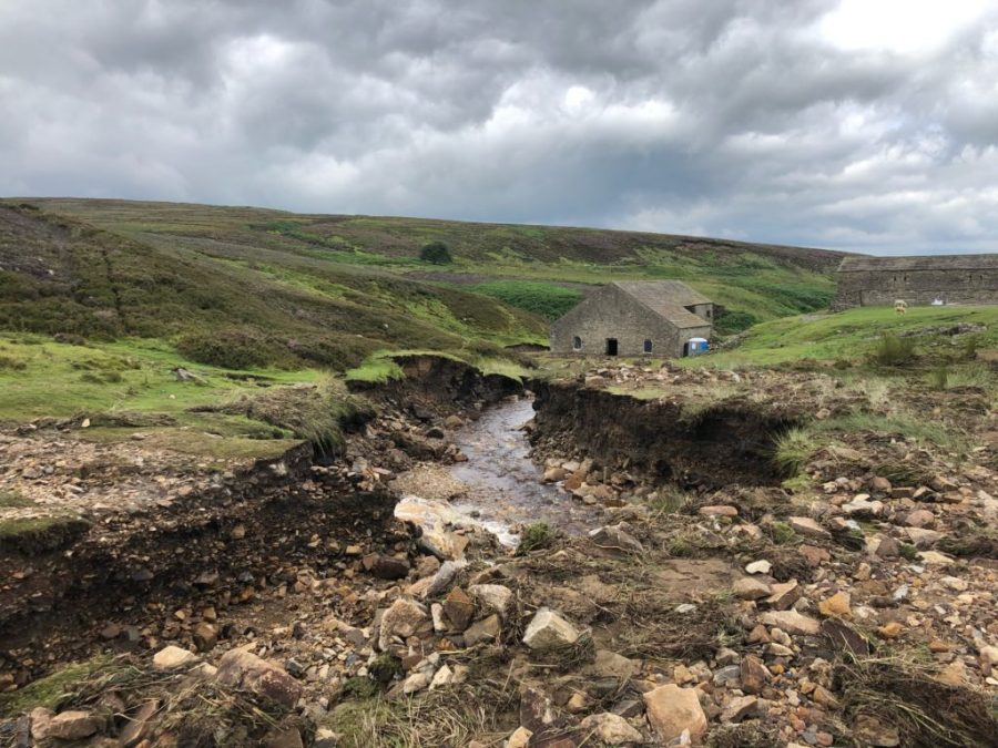 Culvert washed away resulting in open stream