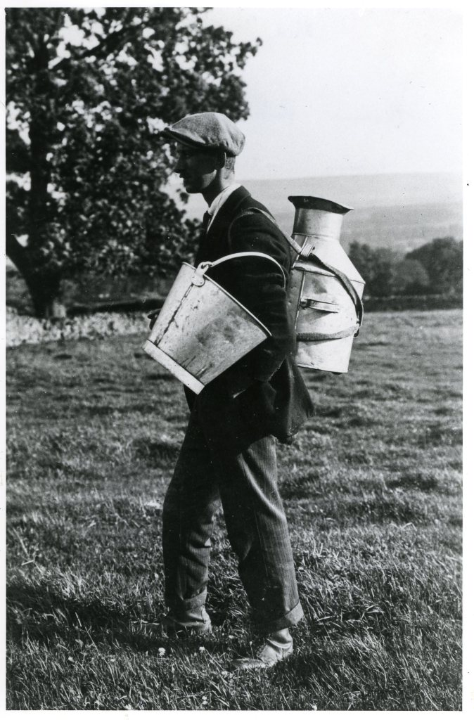 Thomas Park carrying milk from the fields, Redmire. Collection Ann Holubecki