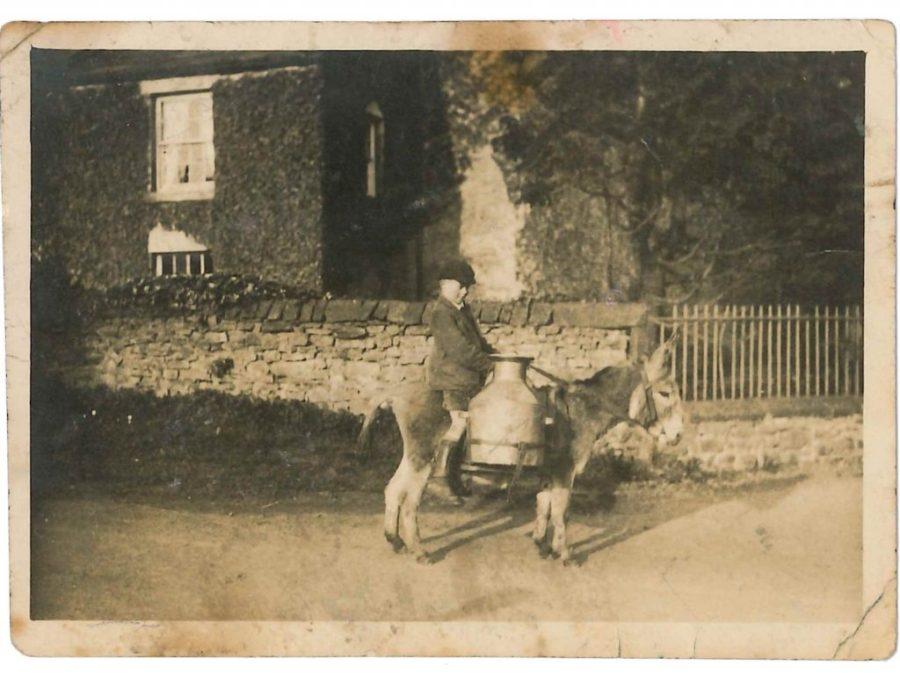Matt Heseltine and donkey with backcans. Courtesy of Eileen Cockburn
