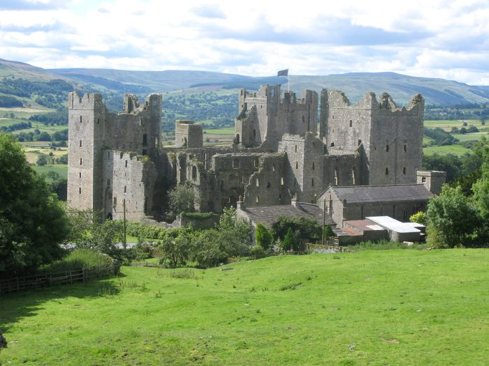 Image shows Bolton Castle from the north against the stunning surrounding landscape