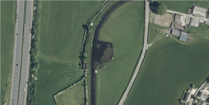 Aerial photo showing Farleton canal basin with ruins of Packet House and stables. Note the M6 motorway to the west and eighteenth century turnpike road to the east © Getmapping Plc and Bluesky International Limited 2021